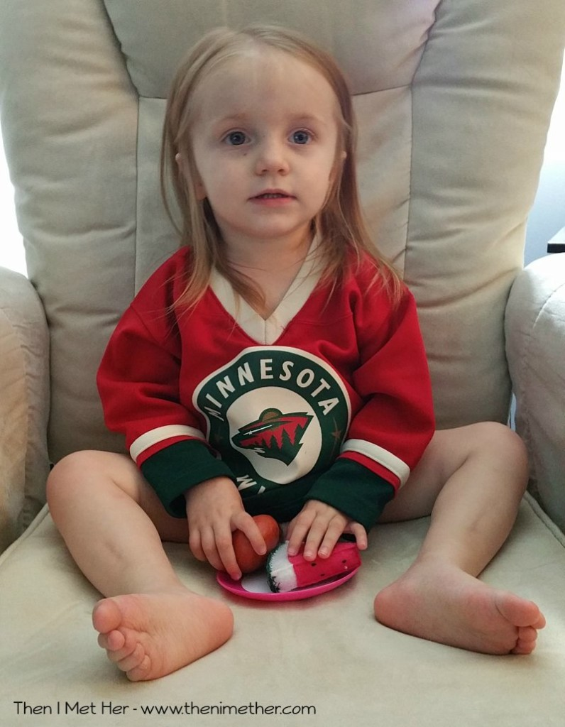 Gradie wearing her Wild Jersey playing with Fake Food